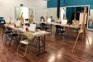Fitness Studio in LoYoBoFit set up with tables and art equipment. Ready for Art Night.